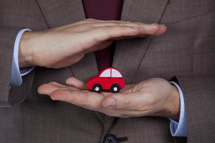 car in mans hands